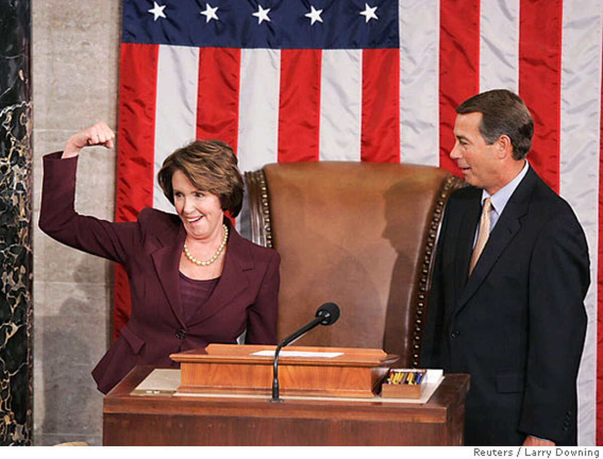 U.S. Speaker of the House Nancy Pelosi (D-CA) reacts as she is introduced by incoming House Minority Leader John Boehner (R-OH) (R) and takes the House podium for the first time after she was elected the first ever female Speaker of the U.S. House of Representatives on the first day of the 110th Congress in Washington January 4, 2007. REUTERS/Larry Downing (UNITED STATES)