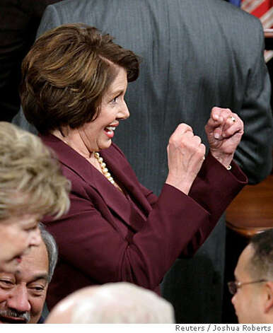 Incoming Speaker of the U.S. House of Representatives Rep. Nancy Pelosi (D-CA) playfully makes fists as if boxing as she jokes with other members of Congress on the House floor on the first day of the 110th Congress as Democrats take power on Capitol Hill in Washington January 4, 2007. REUTERS/Joshua Roberts (UNITED STATES) Photo: JOSHUA ROBERTS