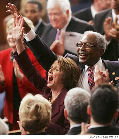 Rep. Nancy Pelosi, D-Calif, and Rep. James Clyburn, D-S.C., wave from the floor of the House of Representatives during the roll call vote to elect a new Speaker of the House in the U.S. Capitol in Washington Thursday, Jan. 4, 2007. (AP Photo/Susan Walsh) Photo: SUSAN WALSH
