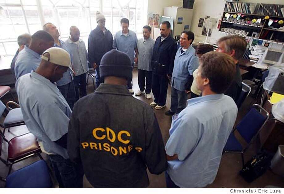 0147_lede08_el.JPG Inmates along with JacqueVerduin and Radhya Stern form in a circle of a silence during class. Inmates along with Radha Stern, Mill Valley, the mother of a murder victim, talks to lifers at San Quentin during the class. She brought along a quilt that was made to honor her son and hangs in her bedroom so she can see it when she awakes in the morning. Inmates touch the quilt as they pass it among themselves. The governor, in attempt to shift the state's corrections policy to rehabilitation rather than punishment, has changed the name of the prisons agency to the state Dept. of Corrections and Rehabilitation. There are 160,000 in the state's rehabilitative institutions. Of those, 27,000 are lifers, with the possibility of parole. In keeping with his views, Gov. Schwarzenegger has paroled 100 in his year in office. Gray Davis paroled six in six years. The question is: What is our view as a society? Do we forgive people of what are heinous crimes to give them a second chance? A group of lifers, working (hopefully) toward parole, meets each Tuesday at San Quentin at 3 p.m. to 5 p.m. with the leader of one of the prison projects. We would like to photograph them to accompany an editorial slated for Sunday.Event on 5/17/05 in San Rafael. Eric Luse / The Chronicle Ran on: 07-01-2005  San Quentin inmates pray during a class led by Jacques Verduin and attended by Radha Stern, the mother of a murder victim. MANDATORY CREDIT FOR PHOTOG AND SF CHRONICLE/ -MAGS OUT Ran on: 07-05-2005  &quo;Lifers&quo; form a circle during a class to help rehabilitate them. Photo: Eric Luse