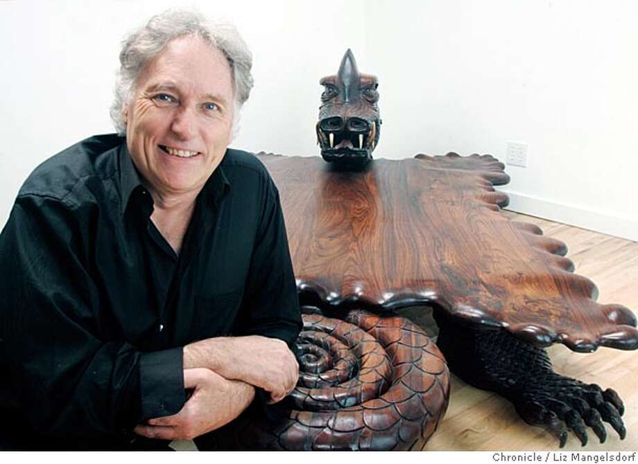 Event on 5/10/05 in Bolinas.  Tom D'Onofrio, an artist in bolinas, who is being profiled in a new segment for National Geographic.  He sits next to the dragon table that he carved for Grace Slick.  Liz Mangelsdorf / The Chronicle Photo: Liz Mangelsdorf