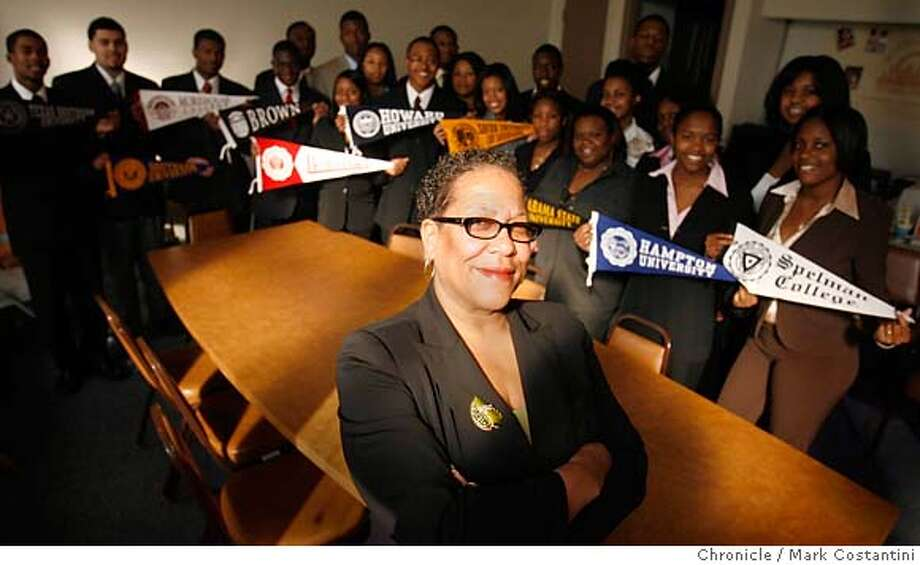 Jefferson award winner Ms. Jacqueline Rushing is the creator, founder, and the Executive Director, of the Young Scholars Program. The program has been in existence for four years. More than 300 students have successfully graduated from high school and are currently enrolled in four-year competitive universities and colleges thanks to the Young Scholars Program.  We will meet her at the classroom  Event on 12/5/06 in San Francisco Photo: Mark Costantini / S.F. Chronicle Jefferson award winner Ms. Jacqueline Rushing(front) is the creator, founder, and the Executive Director, of the Young Scholars Program. The program has been in existence for four years. More than 300 students have successfully graduated from high school and are currently enrolled in four-year competitive universities and colleges thanks to the Young Scholars Program.  Here she is with some of her students who are holding banners of the schools they are or will be attending.  Event on 12/5/06 in San Francisco Photo: Mark Costantini / S.F. Chronicle Photo: Mark Costantini