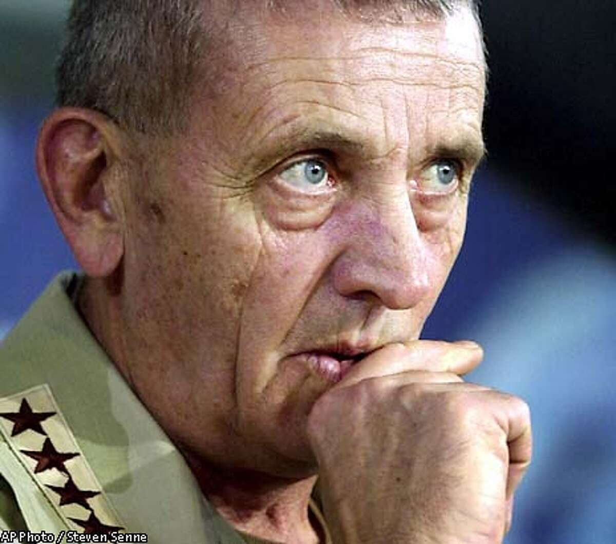 Gen. Tommy Franks, Commander of U.S. Central Command, listens to a question during a news conference at the Coalition Media Center, at Camp As Sayliyah, in Doha, Qatar, Saturday, March 22, 2003. Franks spoke about the progress in the war on Iraq. (AP Photo / Steven Senne)