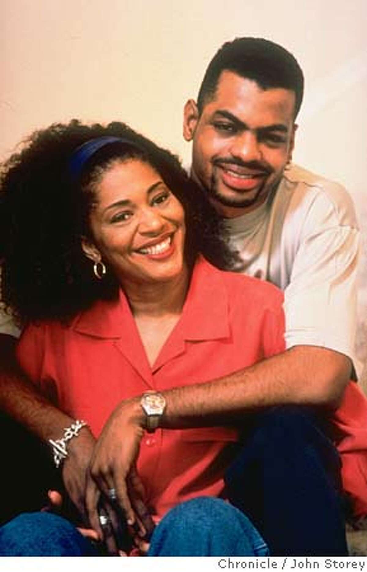 Caption for M&R story 6/26/05: Author Terry McMillan and husband Jonathan Plummer in happier times. Original caption from 1996: Author Terry McMillan, 44, cuddling with her 21-yr-old live-in lover, college student Jonatahan Plummer. (Photo by John Storey//Time Life Pictures/Getty Images)