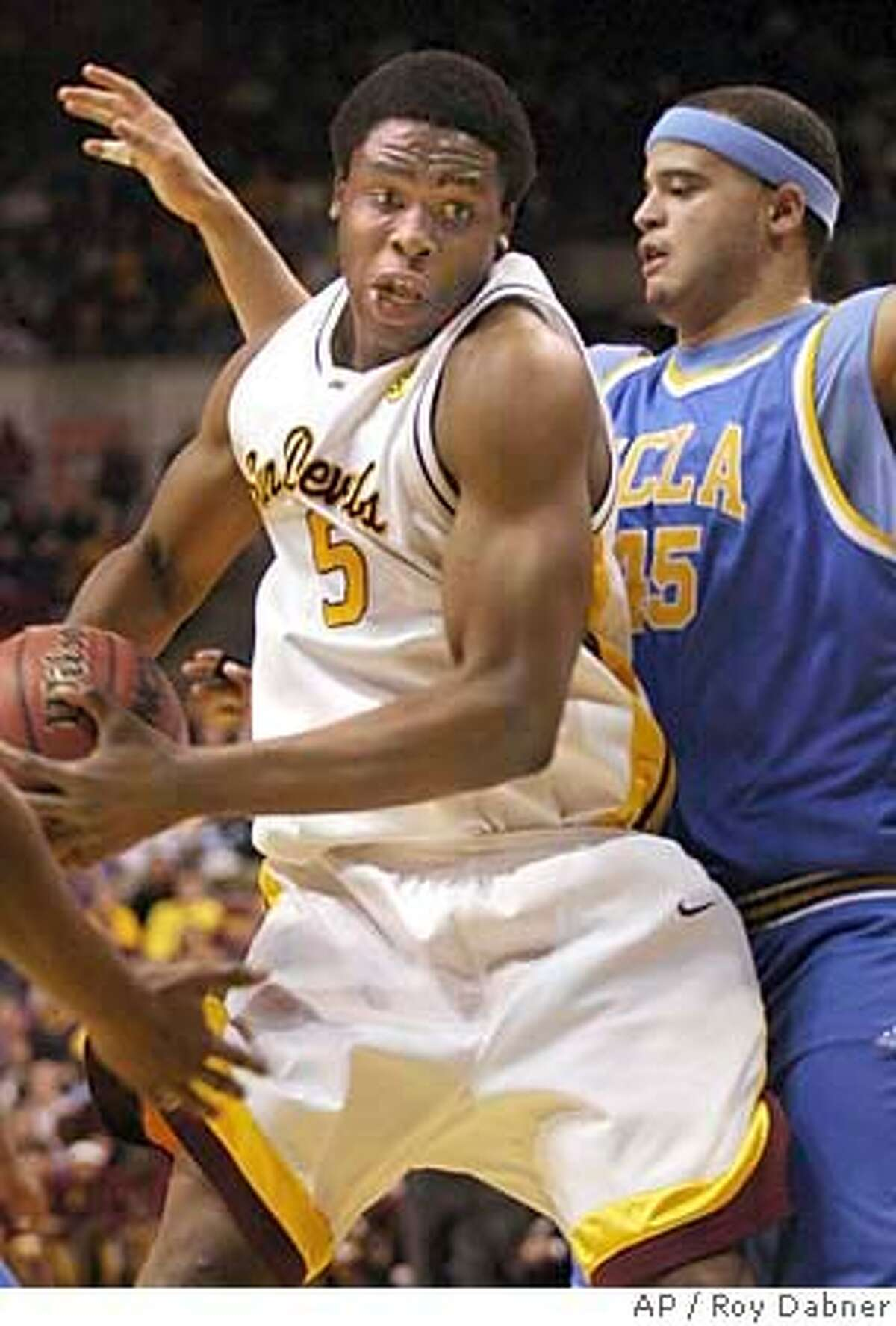** FILE ** Arizona State forward Ike Diogu moves in the lane against UCLA's Michael Fey, right, during the first half, in this Jan. 13, 2005 file photo, in Tempe, Ariz.. Diogu was selected as the No. 9 pick in the NBA Draft by the Golden State Warriors, Tuesday, June 28, 2005. (AP Photo/Roy Dabner)