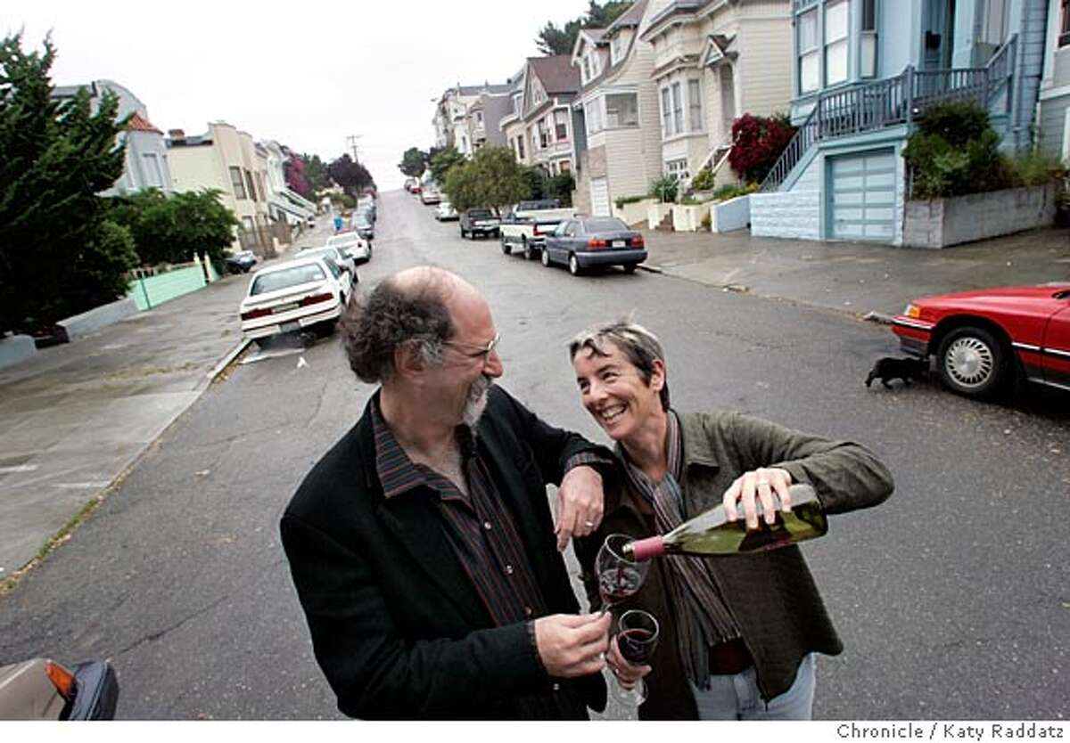 """Joshua Brody (L) and his wife Juliana Grenzeback (R) are married, and live in separate houses, right across the street from one another. Juliana's blue house can be seen on the right of the frame; Joshua's place is hidden by trees on the left. Black cat's name is """"Simon,"""" and he lives with Joshua mostly. Photo taken on 6/16/05, in SAN FRANCISCO, CA. By Katy Raddatz / The San Francisco Chronicle"""
