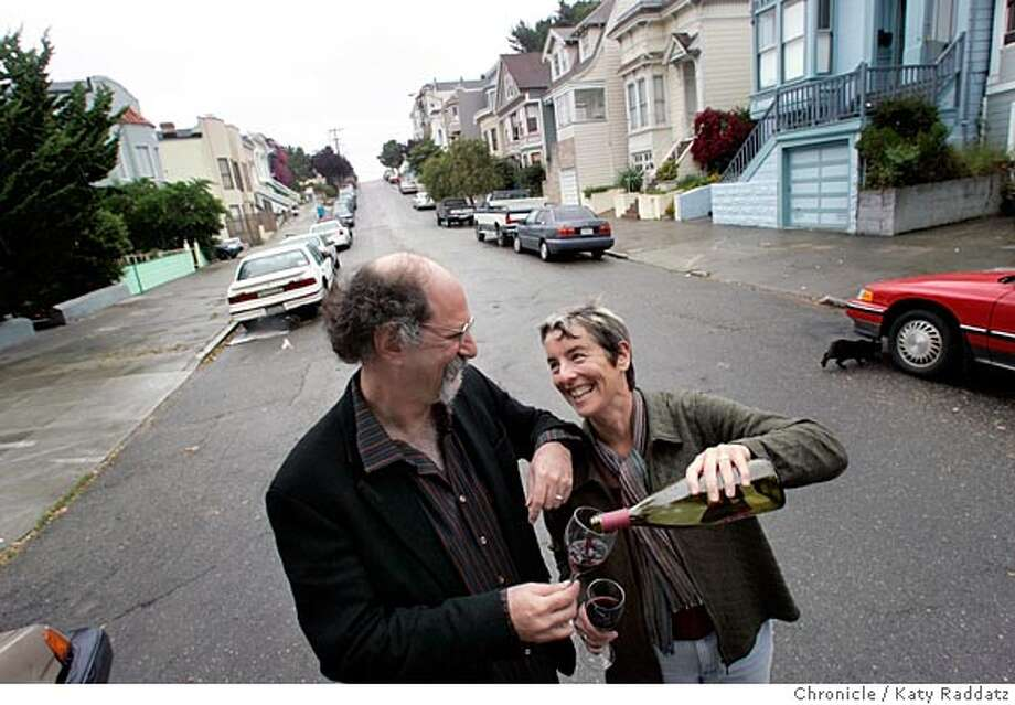 "Joshua Brody (L) and his wife Juliana Grenzeback (R) are married, and live in separate houses, right across the street from one another. Juliana's blue house can be seen on the right of the frame; Joshua's place is hidden by trees on the left. Black cat's name is ""Simon,"" and he lives with Joshua mostly. Photo taken on 6/16/05, in SAN FRANCISCO, CA.  By Katy Raddatz / The San Francisco Chronicle Photo: Katy Raddatz"