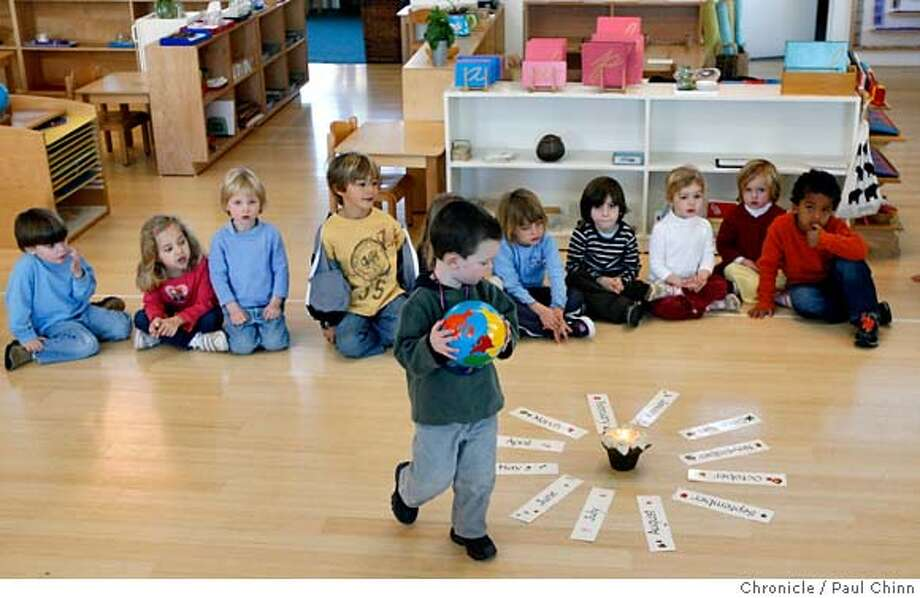 Maclean Boyd walks in a circle around cards with the twelve months of the year to mark his third birthday. Students at Marin Montessori School planted a Fuji apple tree to commemorate the centennial founding of Montessori schools in Corte Madera, Calif. on Friday, Jan. 5, 2007.  PAUL CHINN/The Chronicle  **Maclean Boyd MANDATORY CREDIT FOR PHOTOGRAPHER AND S.F. CHRONICLE/ - MAGS OUT Photo: PAUL CHINN