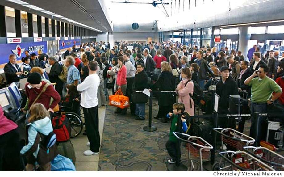 Passengers at Terminal 2 serving Southwest airlines try to check back in after being evacuated.  Dozens of flights out of Oakland International Airport were delayed Friday afternoon after a man bolted past law enforcement and into the secure area of the airport, causing authorities to evacuate one terminal for two hours and the entire facility for about an hour, officials said. By 1 p.m., the airport was reopened and flights were beginning to take off again leaving huge lines as passengers needed to be re-screened.  Photo taken on 1/5/07 by Michael Maloney / San Francisco Chronicle Photo: Michael Maloney