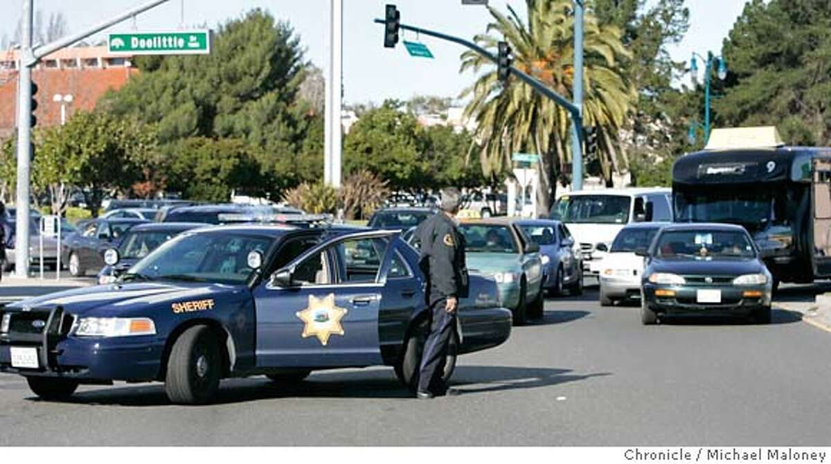 An Alameda County Sheriff stops traffic on Airport Drive leading to the two terminals. Dozens of flights out of Oakland International Airport were delayed Friday afternoon after a man bolted past law enforcement and into the secure area of the airport, causing authorities to evacuate one terminal for two hours and the entire facility for about an hour, officials said. By 1 p.m., the airport was reopened and flights were beginning to take off again leaving huge lines as passengers needed to be re-screened. Photo taken on 1/5/07 by Michael Maloney / San Francisco Chronicle
