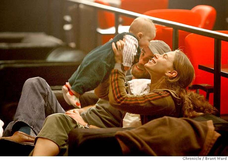 speakeasy208.JPG  Deborah Place, right, holds her daughter Kaia, while father Marty looks on. They enjoy the couches in the front of the theatre.  While independent theaters in the Bay Area continue to close, the owners of the Parkway Speakeasy in Oakland have expanded and renovated the historic Cerrito Theatre in El Cerrito. The Cerrito Speakeasy serves beer, has couches for seating, shows classic movies and continues their popular Baby Brigade shows where infants under a year can attend movies with their parents.  {Brant Ward/San Francisco Chronicle}1/2/07 Photo: Brant Ward
