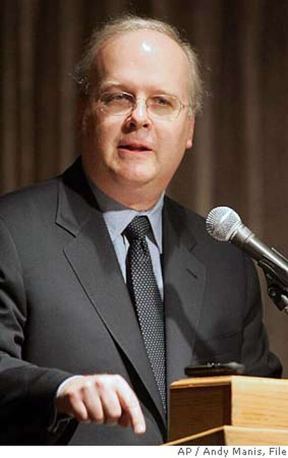 "** FILE ** Karl Rove, President Bush's top political adviser, addresses an audience of Republican supporters in Lake Geneva, Wis., in this April 9, 2005, file photo. Senate Democratic leader Harry Reid said in a statement Thursday, June 23, 2005, that the White House Rove should either apologize or resign for saying liberals responded to the Sept. 11 terrorist strikes by wanting to ""prepare indictments and offer therapy and understanding for our attackers"". (AP Photo/Andy Manis, File) Photo: ANDY MANIS"