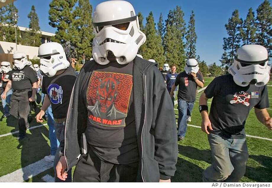 "�Fans dressed as ""Star Wars"" Stormtroopers, practice marching for the 2007 Rose Parade at the Maranatha High School campus in Pasadena, Calif.,Thursday, Dec 28, 2006. (AP Photo/Damian Dovarganes) Photo: Damian Dovarganes"