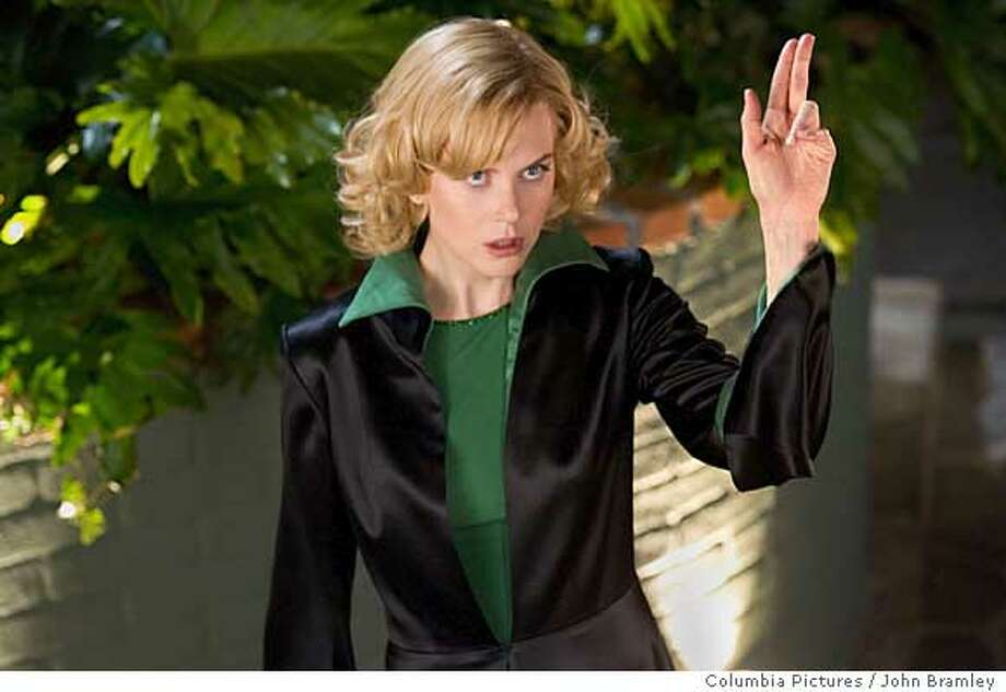 "Actress Nicole Kidman performs in a scene from the new romantic comedy film ""Bewitched"" in this undated publicity photograph. The film, based on the television series ""Bewitched"", is about a witch living in suburban America and opens in the United States June 24, 2005. REUTERS/John Bramley/Columbia Pictures/Handout Photo: HO"