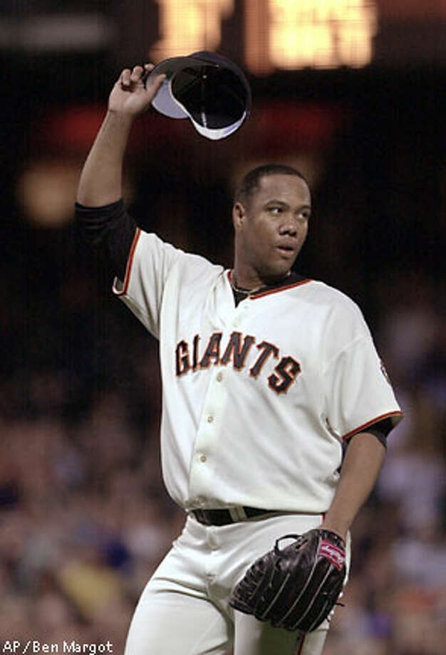 Livan Hernandez, tipping his cap to the home crowd, says he never felt much love from the S.F. fans. Associated Press photo by Ben Margot