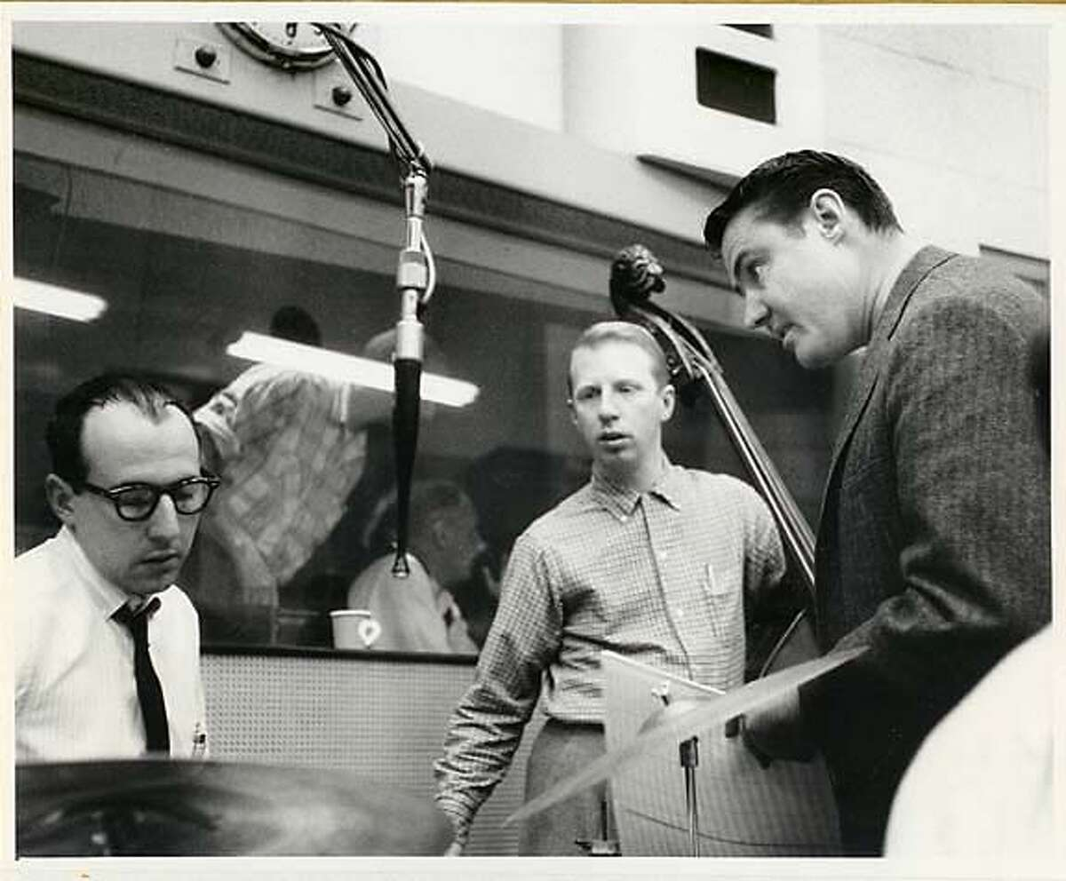 BobThompson (right) directs jazz musicians Red Mitchell (bass) and Frank Capp (drums) during a 1959 recording session at United Studios in Hollywood