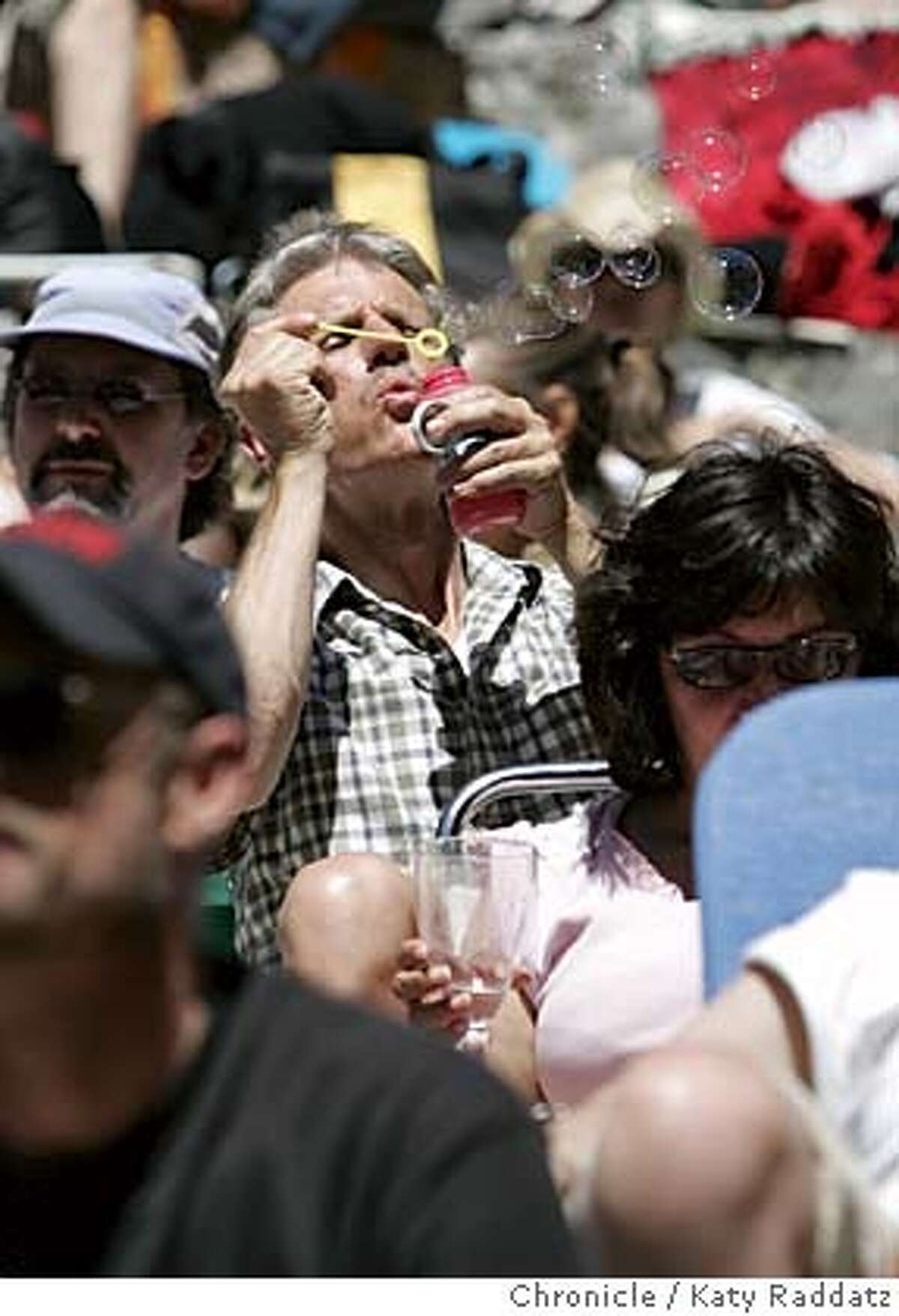 SHOWN: An UNIDENTIFIED MAN in the audience basks in the sunshine and blows bubbles while awaiting the performance. Stern Grove in San Francisco officially opens today, with performances by John Doe and Lucinda Williams. Photo taken on 6/19/05, in SAN FRANCISCO, CA. By Katy Raddatz / The San Francisco Chronicle