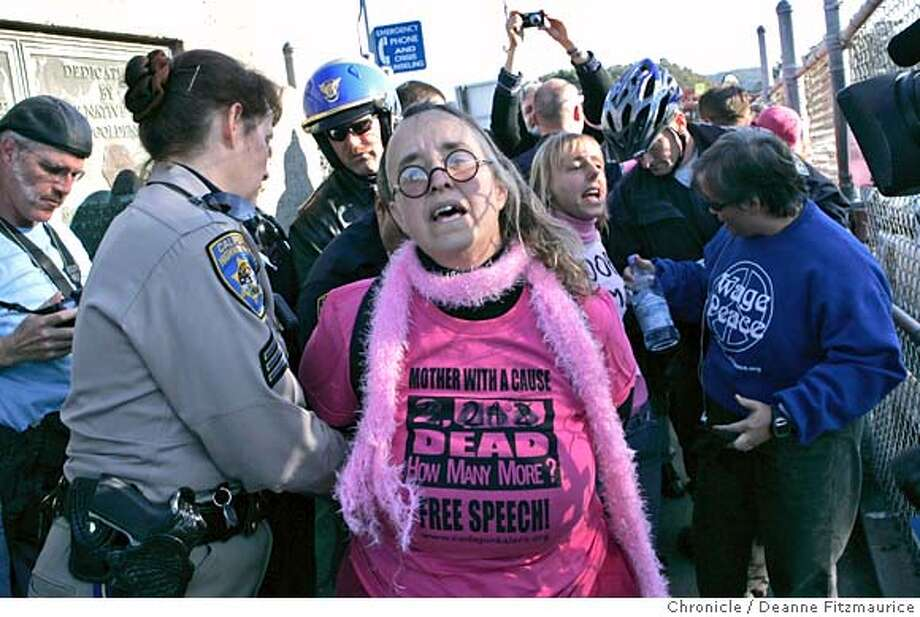 This woman with Code Pink was one of 10 arrested. A rally to mark the 3,000 death of American military personnel in Iraq organized by Code Pink ended in 10 arrests and a shut down of the Golden Gate Bridge to pedestrians and cyclists for hours. Photographed in San Francisco on 1/1/07. (Deanne Fitzmaurice/ The Chronicle) Photo: Deanne Fitzmaurice