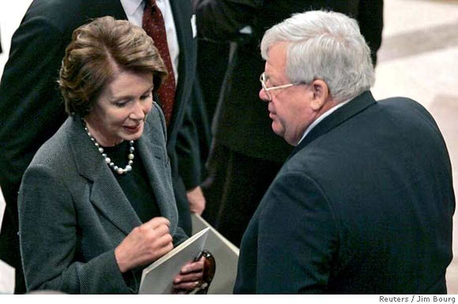 Speaker-elect Nancy Pelosi (L) (D-CA) talks with Speaker of the House Dennis Hastert (R-IL) before the funeral of former U.S. President Gerald Ford at the National Cathedral in Washington, January 2, 2007. REUTERS/Jim Bourg (UNITED STATES) 0 Photo: JIM BOURG