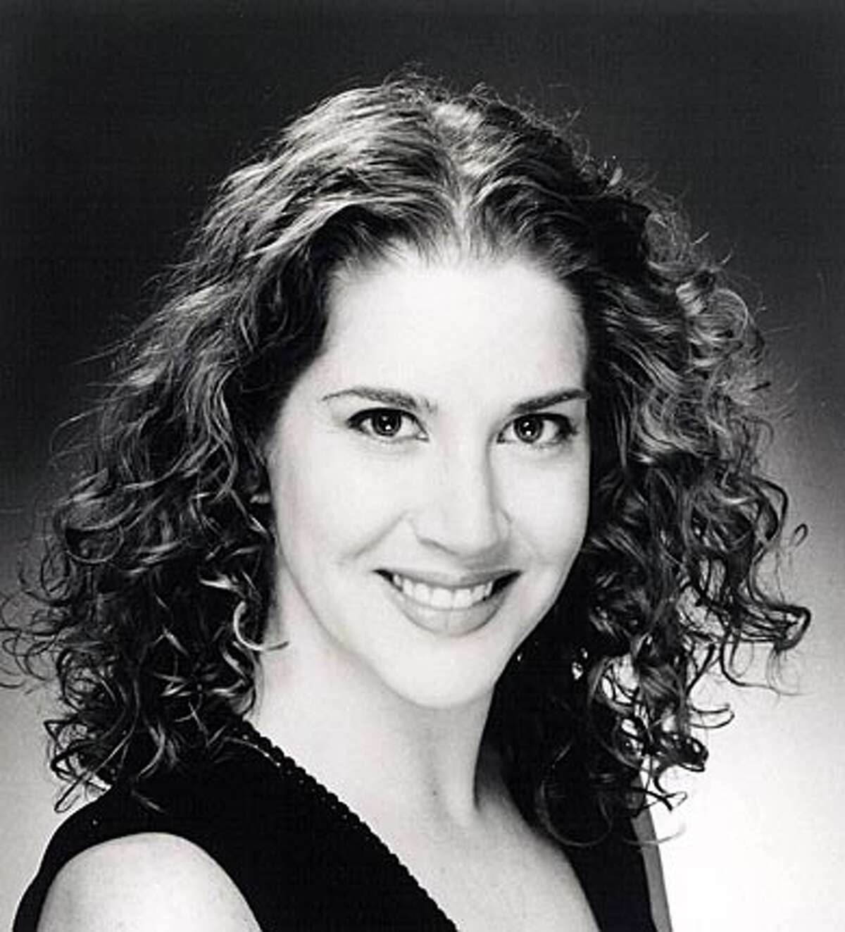 Soprano Heidi Moss with the Livermore Opera Company, takes part in Opera in the Park on June 24, 2005.