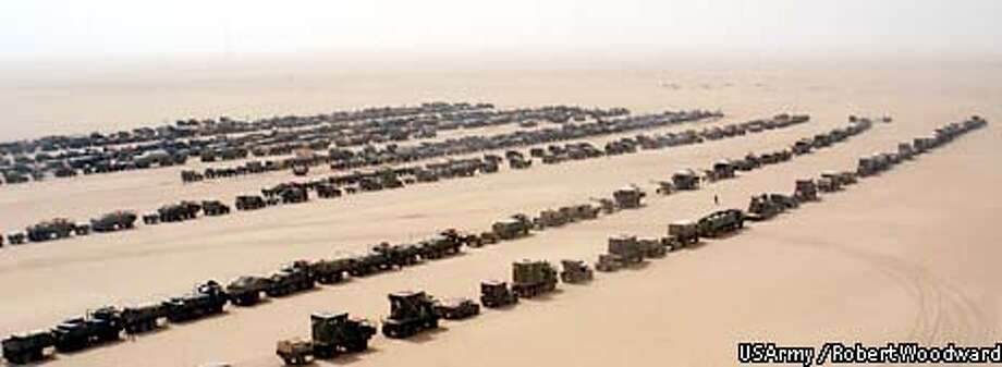 An assault convoy of trucks and amored vehicles of the101st Airborne Division's 3rd Brigade Combat Team prepare to cross into Iraq Friday, March 21, 2003. (AP Photo/Robert Woodward, US Army / Robert Woodward) Photo: ROBERT WOODWARD