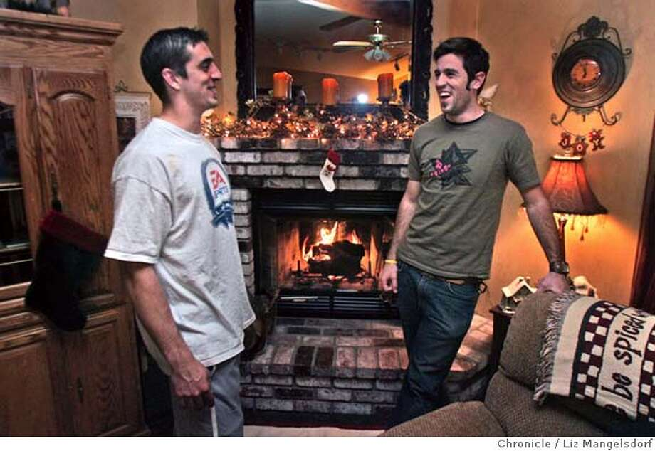 rodgers039_lm.JPG Event on 12/21/04 in Chico.  Cal quarterback Aaron Rodgers. left, laughs as he talks to his older brother Luke Rodgers in the family house in Chico. He is home for a holiday visit. Profile of Cal QB Aaron Rodgers, photographed at his home with his family.  Liz Mangelsdorf / The Chronicle MANDATORY CREDIT FOR PHOTOG AND SF CHRONICLE/ -MAGS OUT Photo: Liz Mangelsdorf