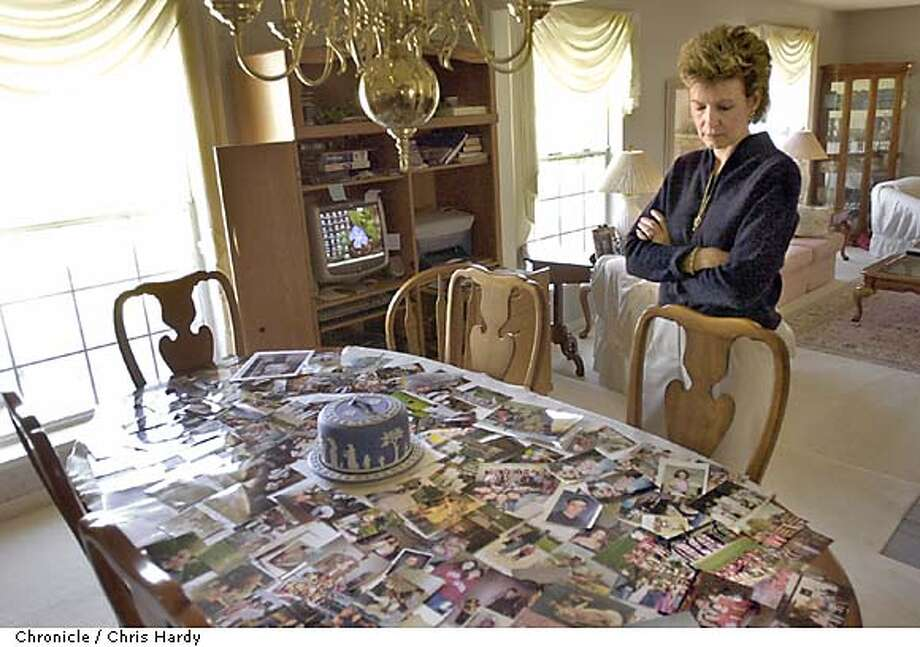 CHRISTINE MCFADDEN, WHOSE CHILDREN WERE KILLED BY HER EX HUSBAND, LOOKING AT PHOTOS OF HER KIDS SPREAD OUT ON HER DININGROOM TABLE  -----CHRONICLE PHOTO BY CHRIS HARDY Photo: Chris Hardy