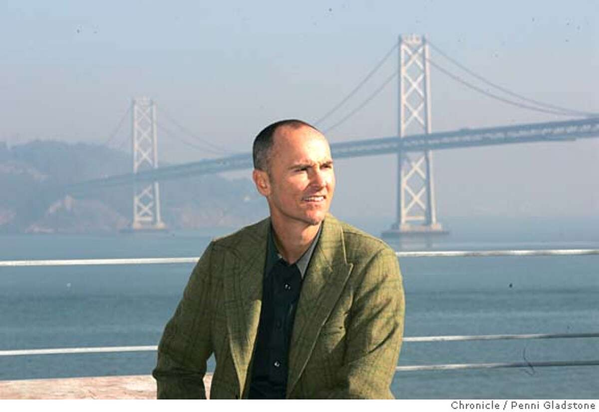 """HOTEL037PG.JPG Chip Conley of Joie de Vivre Hospitality sits on a patio outside a room with this view A lot of people thought it was a dumb idea to build a hotel in 2002, considering what the tech crash and 9/11 did to San Francisco's hospitality industry. But backers of the Hotel Vitale went ahead with their plans, and now they seem ahead of the curve. As the hotel nears completion, hotel occupancy and room rates are on the upswing, though still short of their record 2000 highs. The 189-room property, on the Embarcadero across from the Ferry Building, is positioning itself as a """"post-hip"""" hotel. Photo taken by Penni Gladstone/The San Francisco Chronicle Photo taken on 12/2/04, in San Francisco, CA."""