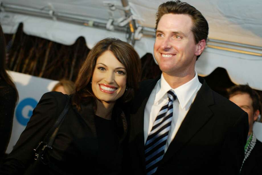 San Francisco Mayor Gavin Newsom (right) and his wife Kimberly Guilfoyle Newsom arrive at the GQ Magazine party honoring the mayor at the Federalist Restaurant, at Fifteen Beacon Hotel after the second night of the Democratic National Convention. Photo: Kat Wade