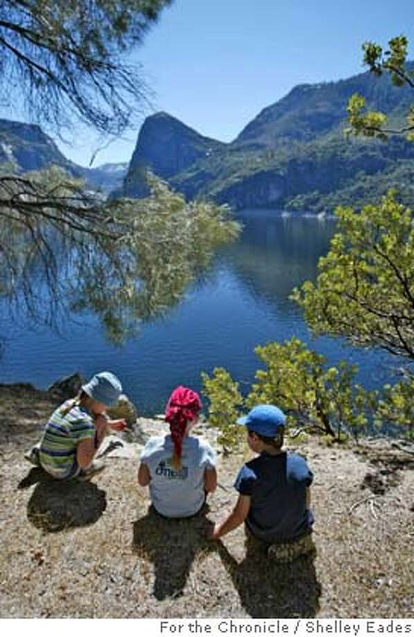 Left to right, Quincy Stivers, 7, Maddie Marchand, 7, and Aiden Stivers, 5, take a break from hiking while on a tour of the Hetch Hetchy area with their parents and a group folks interested in Restoring Hetch Hetchy. Photo by Shelley Eades  Taken on May 22, 2005 Photo: Shelley Eades