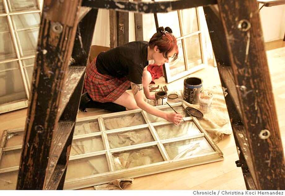 """intersection072_ckh.jpg  CHRISTINA KOCI HERNANDEZ  Artist, Carolyn Rider Cooley, works on her installation,as part of an upcomg show in the art gallery, """"Blueprints.""""As part of our coverage of the 40th anniversary of intersection for the arts, we will sit down with executive director deborah cullinan and also wander around the joint, on valencia, to see various arts projects in the works, talk to personnel etc. Ran on: 06-12-2005 Ran on: 06-12-2005 Photo: CHRISTINA KOCI HERNANDEZ"""