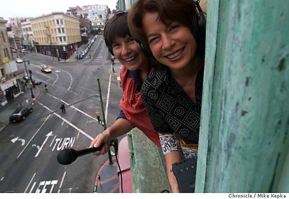 """KITCHENSIS-C-14AUG01-MG-MK - The Kitchen Sisters, Nikki Silva and Davia Nelson, Producers of the public radio project called """"Lost and Found Sound"""" hang out the window of their San Francisco office. BY MIKE KEPKA/THE CHRONICLE Photo: MIKE KEPKA"""