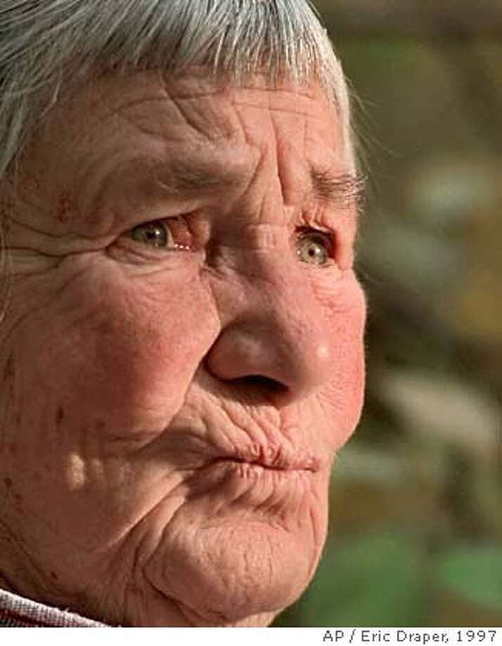 **FILE** Artist Agnes Martin, shown in Taos, N.M., on October 10, 1997, has died. Martin, one of the world's foremost abstract artists, whose spare paintings reflected the simple life she sought, died Thursday, Dec. 16, 2004. She was 92. Martin died at the Plaza de Retiro, a retirement community in Taos, N.M., said William Himes, the community's owner and administrator. Martin had lived a simple life in the artists' haven in northern New Mexico since 1991, even as her art grew in popularity in major cities throughout the world. (AP Photo/Eric Draper) Photo: ERIC DRAPER