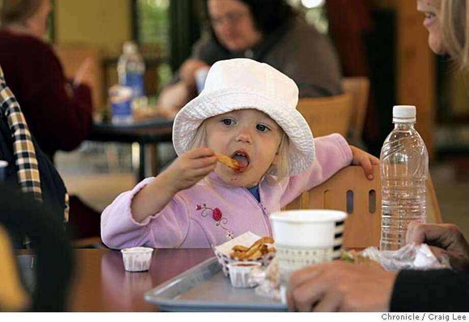 Story on what there is to eat for kids at some summer attractions. The Leaping Lemur Cafe at the San Francisco Zoo. Photo of Hanne Holtan, 2, eating her french fry. She is from San Jose.  Event on 6/2/05 in San Francisco. Craig Lee / The Chronicle Photo: Craig Lee