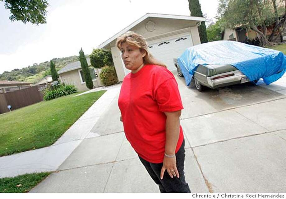 CHRISTINA KOCI HERNANDEZ/CHRONICLE  Rosey Contreras, a stay at home mother, who lives two houses down from Dean, stands in front of his house.That is Dean's car in the background.We talk to neighbors of Dean Arthur Schwartzmiller, 63, who has been charged with seven felony counts of molestation involving two 12-year- old San Jose boys. Photo: CHRISTINA KOCI HERNANDEZ