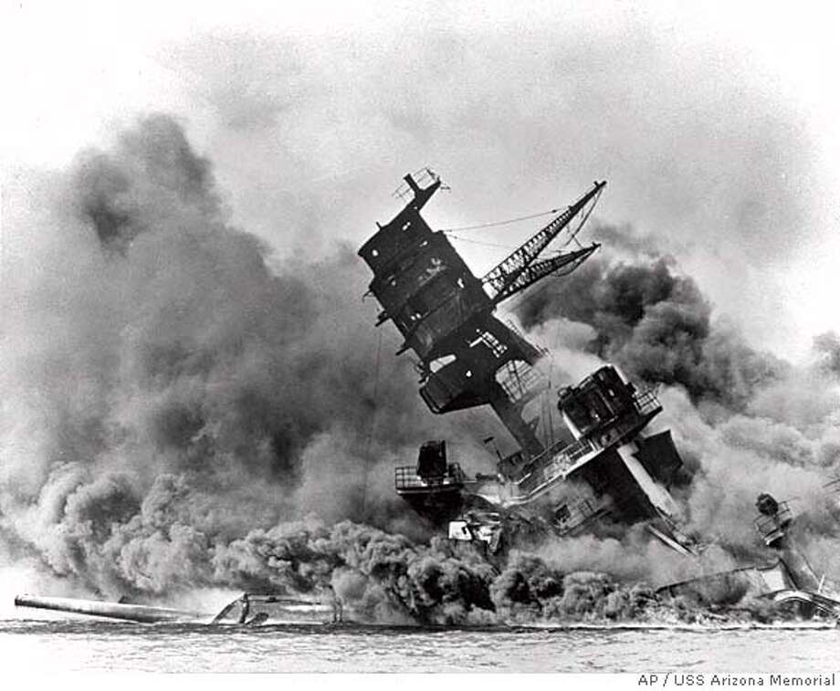 ADVANCE FOR WEEKEND EDITIONS DEC. 1-2--FILE--Smoke rises from the USS Arizona as the ship sinks in this Dec. 7, 1941 black-and-white file photo from the attack on Pearl Harbor. The attacks of Sept. 11 briefly halted sports. It was not the first time sports has felt the impact of world affairs. Sixty years ago this week, Japanese planes bombed Pearl Harbor, plunging the United States into World War II. (AP Photo/USS Arizona Memorial), Also appeared 12/06/02 Ran on: 07-04-2004  The battleship Arizona sinks in the Pearl Harbor attack, which prompted creation of the CIA. CAT