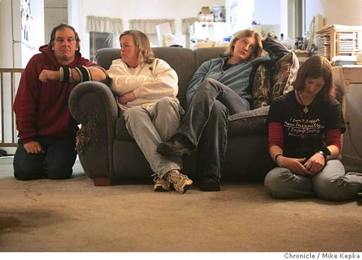 Jim and Eileen Hanson and their daughters Jamie and Joy Hanson are trying to cope with the loss of 16-year-old Joel a year after his tragic death which resulted life saving organ transplants for two different people. 12/14/04 Mike Kepka/The Chronicle