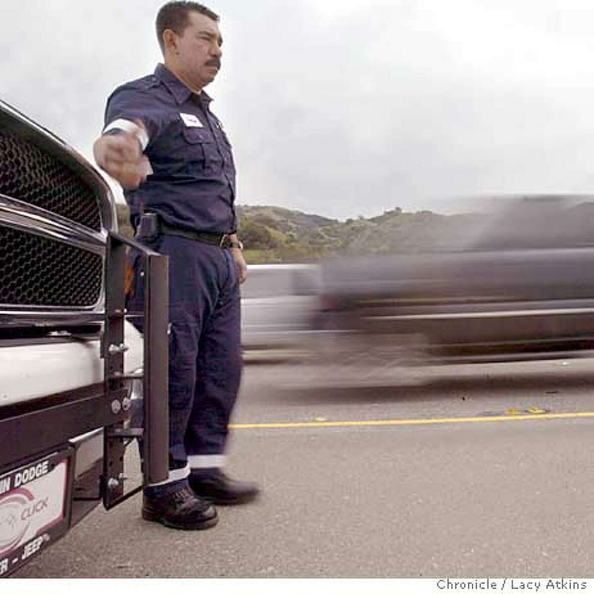 Enrique Julia, operations supervisor for Orange County 91 Express Lanes at the baracade between the lanes on Highyway 91, in Anaheim, Dec. 7,2004. The toll express lanes on highway 91 in Anaheim, Dec. 7, 2004. The Express lane is a lane commuters if not carpooling can pay a toll through Fast Track to drive in. LACY ATKINS/SAN FRANCISCO CHRONICLE