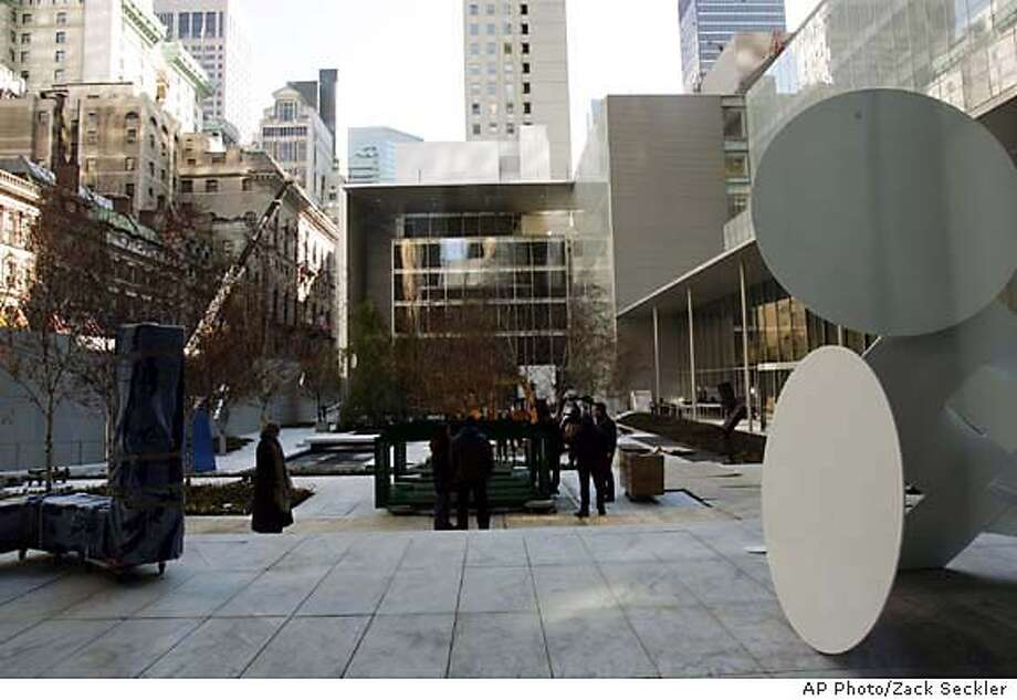 This view shows the rebuilt sculpture garden at the renovated Museum of Modern Art (MoMA) set in a high-rise neighborhood just off New York's Fifth Avenue on Nov. 14, 2004. The museum re-opens to the public on Saturday, Nov. 20. (AP Photo/Zack Seckler) Ran on: 11-21-2004  The new Skyscraper Museum's innovative design uses reflective surfaces to appear roomier. Photo: ZACK SECKLER