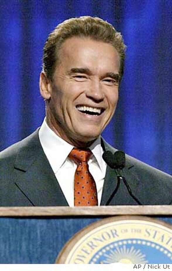 "** FILE ** California Gov. Arnold Schwarzenegger, left, appears with actress Jamie Lee Curtis at the 2004 California Governor's Conference on Women and Families in Long Beach, Calif., in this Tuesday, Dec 7, 2004, file photo. The Republican governor, who rode to fame making tough-guy action films and who's been accused by dozens of women of being a serial groper, stood before a state women's conference and boasted that he had angered a group of nurses because he was ""always kicking their butts."" (AP Photo/Nick Ut) A TUESDAY, DEC. 7, 2004 FIEL PHOTO Photo: NICK UT"