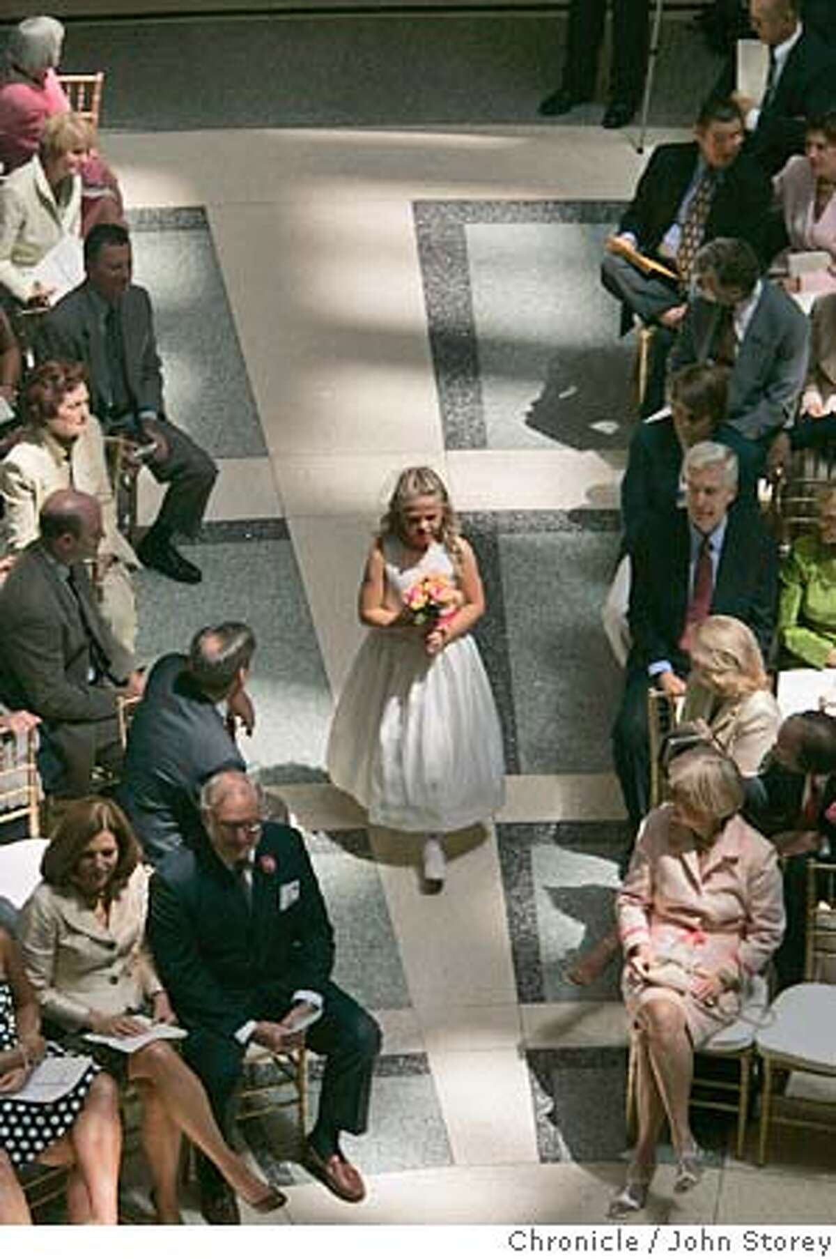 Wedding_jrs_0192.jpg A flower walks down the aisle before the ceremony. Mayor Oakland Jerry Brown gets married to Anne Gust by Senator Diane Feinstein at the Rotunda Building in Oakland. John Storey Oakland Event on 6/18/05 MANDATORY CREDIT FOR PHOTOG AND SF CHRONICLE/ -MAGS OUT