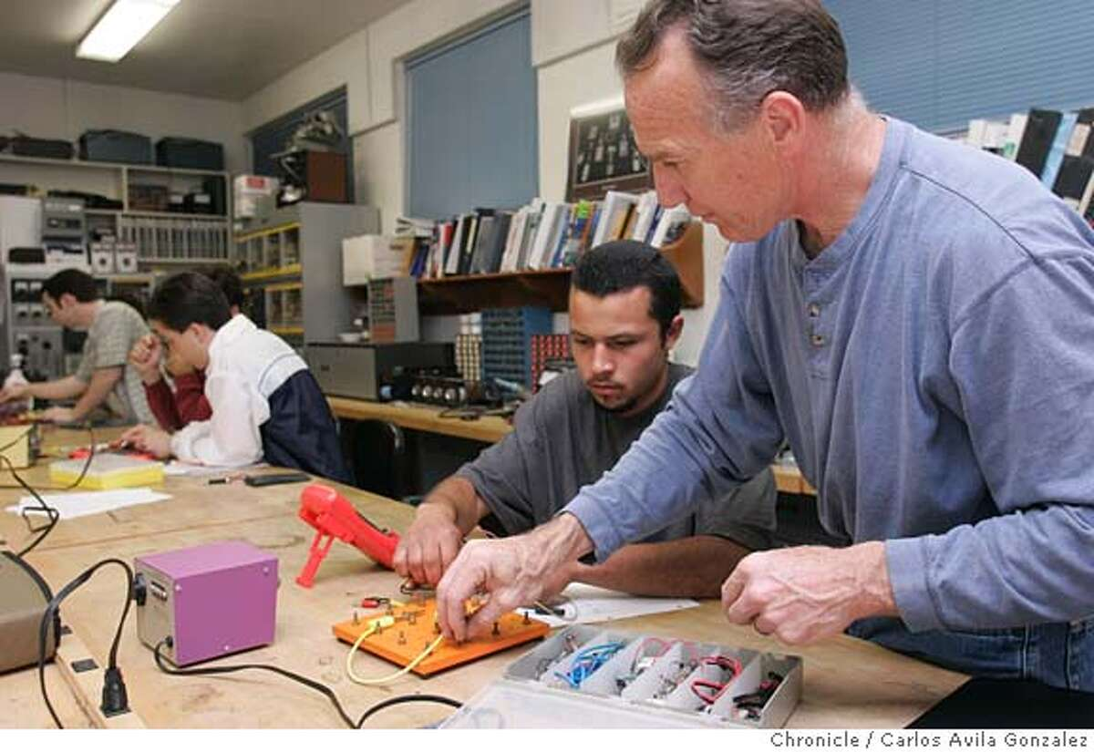 Instructor, Pat Martucci, assists student, Efren Martinez with a circuitry exercise during lab at USS Posco Industries, in Pittsburg, Ca., on Wednesday, March 8, 2005. Blue collar jobs, once a mainstay of the local economy and a beacon for high school kids who knew they could always get a union job at a refinery or the sugar plant after graduation, are a vanishing way of life in cities like Crockett, Martinez and Pittsburg. Fewer kids have any interest in following their fathers and grandfathers into the Chevron refinery or the C&H Sugar Plant, and their parents are less inclined to let them. Photo by Carlos Avila Gonzalez / The San Francisco Chronicle Photo taken on 3/9/05 in Pittsburg, CA.