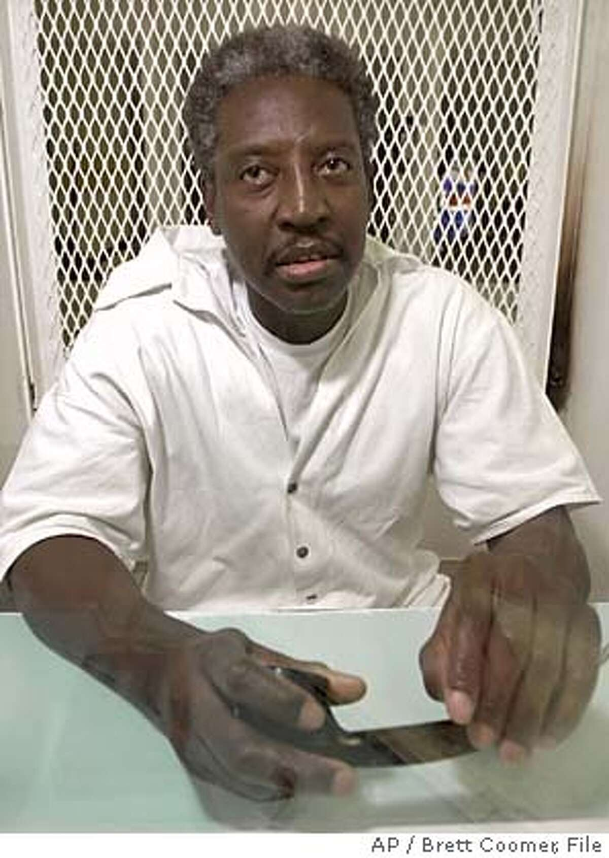**FILE** Death row inmate Thomas Miller-El, sits in a visitation cell at the Texas Department of Criminal Justice's the Polunsky Unit in Livingston, Texas, in a Wednesday, Feb. 20, 2002 photo. The Supreme Court overturned the conviction of Miller-El Monday, June 13, 2005, ordering a new trial for Miller-El and issuing a harsh rebuke to the state that executes more people than any other. (AP Photo/Brett Coomer, File) A WEDNESDAY, FEB. 20, 2002 FILE PHOTO.