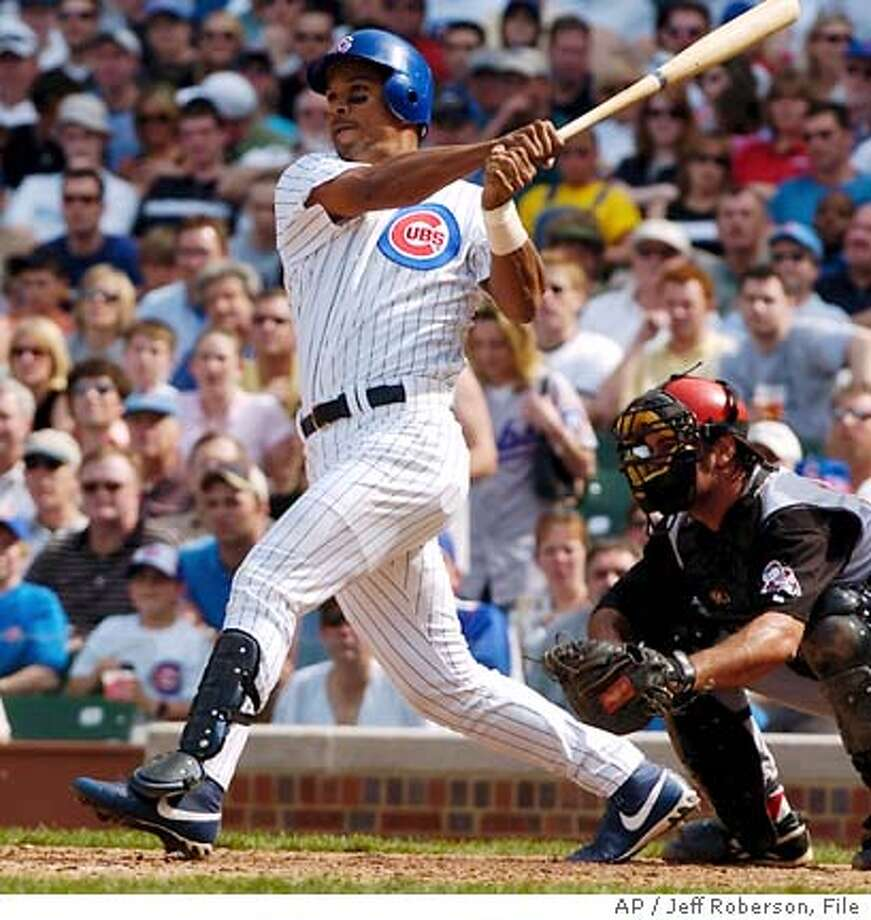 Chicago Cubs' Moises Alou hits a home run in the third inning against the Cincinnati Reds Friday, April 16, 2004 in Chicago. Later Alou hit a walk-off home run in the bottom of the ninth to win the game 11-10. (AP Photo/Jeff Roberson) Photo: JEFF ROBERSON