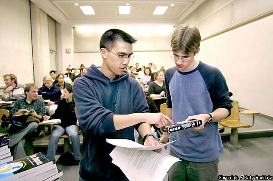 "Instructor Tyler Shores, left, and student assistant Max Helix discuss the video clips they will show during a meeting of their ""Simpsons and Philosophy"" class at UC Berkeley. Chronicle photo by Katy Raddatz"