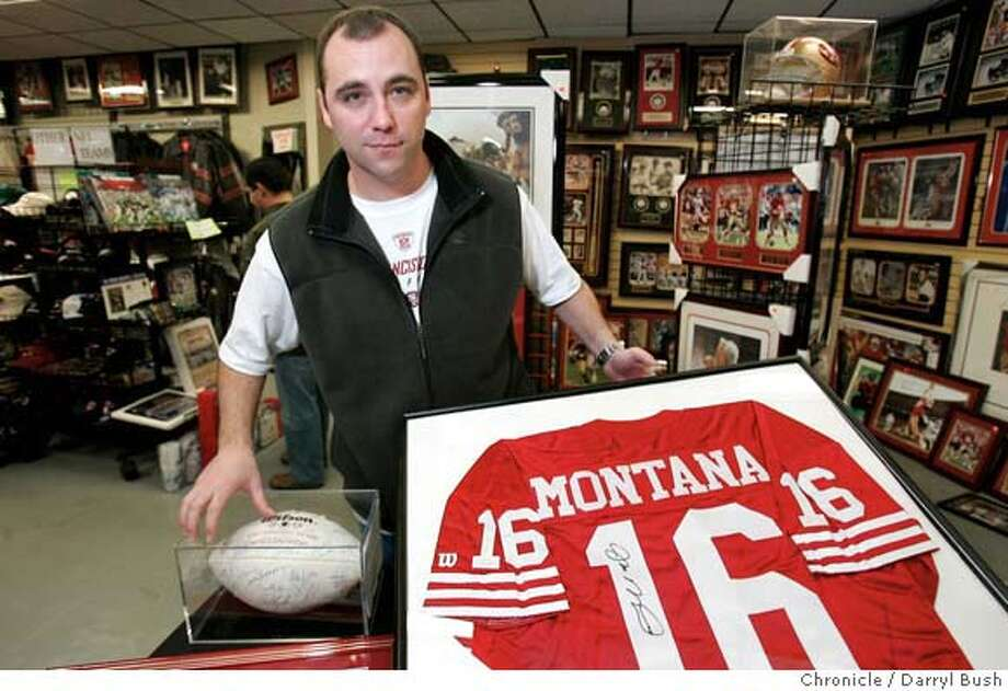 """iraq_fans_076_db.jpg  Mike Herkenrath. owner of """"The Fan Club,"""" a sports memorabilia store, talks about items for aution that he's helping to sell, to provide money that will help three local soldiers buy things such as body armor, to help them on their upcoming deployment to Iraq. Many of the items for auction are owned by one of the three soldiers. The items are: original 80's Wilson jersey signed by Joe Montana, 49ers 1984 super bowl team football signed by the team. 12/21/04 in San Jose  Darryl Bush / The Chronicle MANDATORY CREDIT FOR PHOTOG AND SF CHRONICLE/ -MAGS OUT Photo: Darryl Bush"""