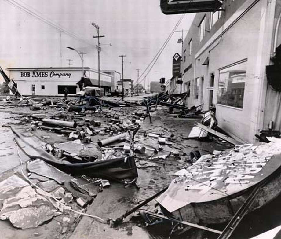 3/28/64 Crescent City, Cailf: Marshall law was declared this morning in debris littered Crescent City streets after tidal waves destroyed 150 businesses and killed at least nine persons. UPI photo. Ran on: 12-29-2004  Debris litters the streets of Crescent City (Del Norte County) in March of 1964 after the coastal town was clobbered by a tsunami. Ran on: 12-29-2004  Debris litters the streets of Crescent City (Del Norte County) in March of 1964 after the coastal town was clobbered by a tsunami.