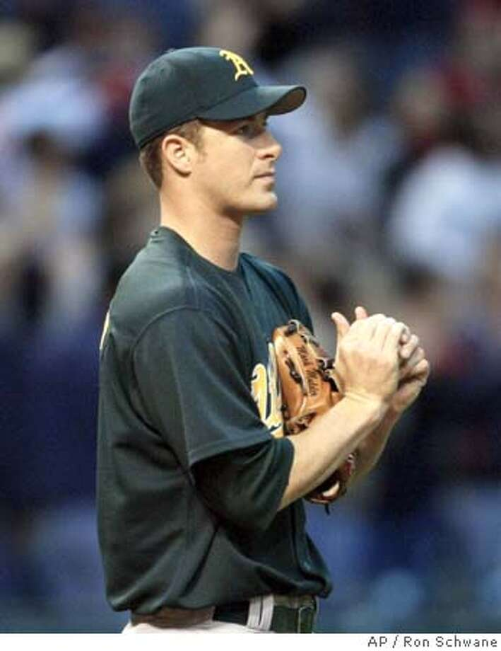 Oakland Athletics' Mark Mulder works a new ball after Cleveland Indians' Ellis Burks hit a two-run home run in the sixth inning Friday, May 16, 2003 at Jacobs Field in Cleveland. The Indians won 3-2. (AP Photo/Ron Schwane) CAT Photo: RON SCHWANE