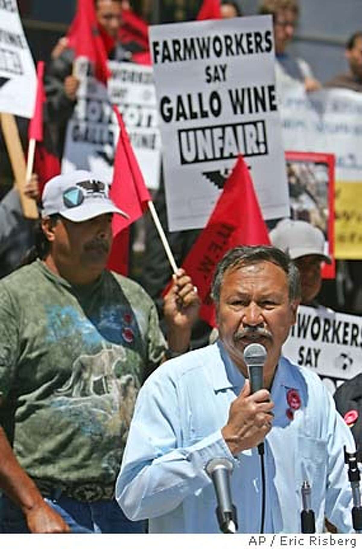 Arturo Rodriguez, right, president of the United Farm Workers union calls for a boycott of Gallo wine during a rally outside City Hall in San Francisco, Tuesday June 14, 2005. The United Farm Workers union is asking consumers to stop buying Gallo wine, saying the California vintner isn't treating workers fairly in contract negotiations. The rally kicked off the UFW's first major nationwide boycott in more than 20 years. At left is Antonio Campa, a 26-year employee at Gallo wine in Sonoma County.(AP Photo/Eric Risberg)