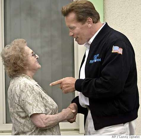 California Gov. Arnold Schwarzenegger speaks with Hermine Kendrick outside her home prior to a visit with a neighborhood group in Santee, Calif., Tuesday June 14, 2005. Schwarzenegger launched his official campaign Tuesday for three reform measures by visiting Paul and Hermine Kendrick, a retired couple who said they couldn't afford any new property taxes to cover state spending. (AP Photo/Lenny Ignelzi) Photo: LENNY IGNELZI